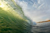 A green wave breaking, with sunset light filtering through. Ponto, Carlsbad, California, USA. Image #19395