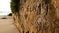 Graffiti is carved into soft sandstone cliffs at the beach. Carlsbad, California, USA. Image #19812