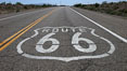 Route 66 (also known as U.S. Route 66, The Main Street of America, The Mother Road and the Will Rogers Highway) was a highway in the U.S. Highway system. One of the original federal routes, US 66 was established in 1926 and originally ran from Chicago through Missouri, Kansas, Oklahoma, Texas, New Mexico, Arizona, and California, before ending at Los Angeles for a total of 2,448 miles.  US 66 was officially decommissioned (i.e., removed from the offical U.S. Highway system) in 1985 after it was decided the route was no longer relevant and had been replaced by the Interstate Highway System. USA. Image #20567