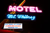Mt. Whitney Hotel, near signs at night. Lone Pine, California, USA. Image #21764