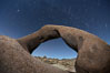 Mobius Arch in the Alabama Hills, seen here at night with swirling star trails formed in the sky above due to a long time exposure. Alabama Hills Recreational Area, California, USA. Image #21772