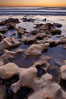 Rocks along the edge of the ocean at sunset. Carlsbad, California, USA. Image #22195