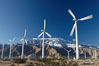 Wind turbines, rise above the flat floor of the San Gorgonio Pass near Palm Springs, with snow covered Mount San Jacinto in the background, provide electricity to Palm Springs and the Coachella Valley. California, USA. Image #22205