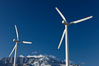 Wind turbines, rise above the flat floor of the San Gorgonio Pass near Palm Springs, with snow covered Mount San Jacinto in the background, provide electricity to Palm Springs and the Coachella Valley. California, USA. Image #22206