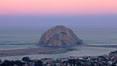Earth shadow over Morro Rock and Morro Bay.  Just before sunrise the shadow of the Earth can seen as the darker sky below the pink sunrise. California, USA. Image #22213