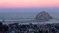Earth shadow over Morro Rock and Morro Bay.  Just before sunrise the shadow of the Earth can seen as the darker sky below the pink sunrise. California, USA. Image #22214