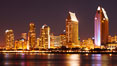 San Diego city skyline at night, showing the buildings of downtown San Diego reflected in the still waters of San Diego Harbor, viewed from Coronado Island. San Diego, California, USA. Image #22250