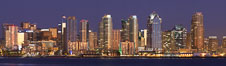 San Diego city skyline at sunset, showing the buildings of downtown San Diego rising above San Diego Harbor, viewed from Harbor Island.  A panoramic photograph, composite of thirteen separate images. San Diego, California, USA. Image #22255