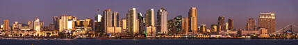 San Diego city skyline at sunset, showing the buildings of downtown San Diego rising above San Diego Harbor, viewed from Harbor Island.  A panoramic photograph, composite of six separate images. San Diego, California, USA. Image #22256