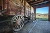 Wagon and interior of County Barn, Brown House and Moyle House in distance. Bodie State Historical Park, California, USA. Image #23106