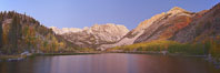 North Lake lit by alpenglow before sunrise, a three frame panorama, with groves of yellow and orange aspen trees on the side of Paiute Peak. Bishop Creek Canyon, Sierra Nevada Mountains, California, USA. Image #23336