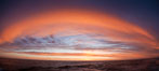 Sunset clouds create a colorful arch, spanning the heavens from horizon to horizon, over the open sea between the Falkland Islands and South Georgia Island. Southern Ocean. Image #24073