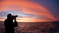 Photographer takes picture of a spectacular sunset arch, spanning the heavens from horizon to horizon, over the open sea between the Falkland Islands and South Georgia Island. Southern Ocean. Image #24096