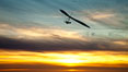 Hang Glider soaring at Torrey Pines Gliderport, sunset, flying over the Pacific Ocean. La Jolla, California, USA. Image #24291