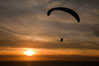 Paraglider soaring at Torrey Pines Gliderport, sunset, flying over the Pacific Ocean. La Jolla, California, USA. Image #24296