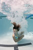 Young girl swimming in a pool. Image #25287