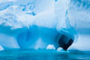 Antarctic icebergs, sculpted by ocean tides into fantastic shapes. Cierva Cove, Antarctic Peninsula, Antarctica. Image #25502