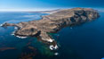 San Clemente Island Pyramid Head, the distinctive pyramid shaped southern end of the island.  San Clemente Island Pyramid Head, showing geologic terracing, underwater reefs and giant kelp forests. California, USA. Image #26003