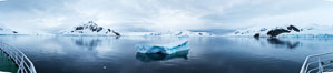 Iceberg and mountain panorama, cloudy morning. Paradise Bay, Antarctic Peninsula, Antarctica. Image #26311