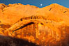 Setting moon over natural sandstone arch, sunrise. Valley of Fire State Park, Nevada, USA. Image #26481