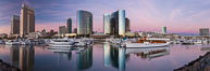 Panoramic photo of San Diego embarcadero, showing the San Diego Marriott Hotel and Marina (center), Roy's Restaurant (center) and Manchester Grand Hyatt Hotel (left) viewed from the San Diego Embacadero Marine Park. California, USA. Image #26565