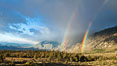 Double rainbow forms in storm clouds, over Swall Meadows and Round Valley in the Eastern Sierra Nevada. Bishop, California, USA. Image #26883