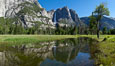 Yosemite Falls reflected in flooded meadow.  The Merced  River floods its banks in spring, forming beautiful reflections of Yosemite Falls. Yosemite National Park, California, USA