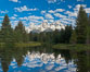The Grand Tetons, reflected in the glassy waters of the Snake River at Schwabacher Landing, on a beautiful summer morning. Grand Teton National Park, Wyoming, USA. Image #26923
