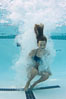 Athletic young girl underwater, performing isometric exercises. Image #27056