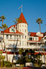 Hotel del Coronado, known affectionately as the Hotel Del. It was once the largest hotel in the world, and is one of the few remaining wooden Victorian beach resorts. It sits on the beach on Coronado Island, seen here with downtown San Diego in the distance. It is widely considered to be one of Americas most beautiful and classic hotels. Built in 1888, it was designated a National Historic Landmark in 1977. San Diego, California, USA. Image #27106