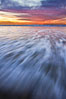 Sunset and incoming surf, gorgeous colors in the sky and on the ocean at dusk, the incoming waves are blurred in this long exposure. Carlsbad, California, USA. Image #27154