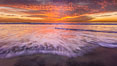 Sunset and incoming surf, gorgeous colors in the sky and on the ocean at dusk, the incoming waves are blurred in this long exposure. Carlsbad, California, USA. Image #27156