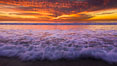 Sunset and incoming surf, gorgeous colors in the sky and on the ocean at dusk, the incoming waves are blurred in this long exposure. Carlsbad, California, USA. Image #27158