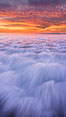 Sunset and incoming surf, gorgeous colors in the sky and on the ocean at dusk, the incoming waves are blurred in this long exposure. Carlsbad, California, USA. Image #27159