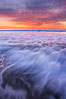 Sunset and incoming surf, gorgeous colors in the sky and on the ocean at dusk, the incoming waves are blurred in this long exposure. Carlsbad, California, USA. Image #27160