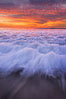 Sunset and incoming surf, gorgeous colors in the sky and on the ocean at dusk, the incoming waves are blurred in this long exposure. Carlsbad, California, USA. Image #27161