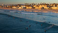 The coast of Oceanside California, waves and surfers, beach houses, just before sunset, winter, looking north. Oceanside Pier, USA. Image #27605