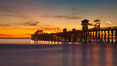 Oceanside Pier at sunset, clouds with a brilliant sky at dusk, the lights on the pier are lit. California, USA. Image #27617