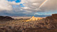 Rainbow and clearing storm clouds, sunrise light on Manly Beacon, Zabriskie Point, Death Valley National Park, California. USA. Image #27660