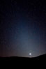 Zodiacal light over Death Valley.  Zodiacal light is a faint diffuse light seen along the plane of the ecliptic in the vicinity of the setting or rising sun, caused by sunlight scattered off space dust in the zodiacal cloud. Racetrack Playa, Death Valley National Park, California, USA
