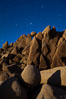 Boulders and stars, moonlight in Joshua Tree National Park. The moon gently lights unusual boulder formations at Jumbo Rocks in Joshua Tree National Park, California. Joshua Tree National Park, California, USA. Image #27717