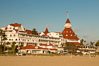Hotel del Coronado, known affectionately as the Hotel Del. It was once the largest hotel in the world, and is one of the few remaining wooden Victorian beach resorts. It sits on the beach on Coronado Island, seen here with downtown San Diego in the distance. It is widely considered to be one of Americas most beautiful and classic hotels. Built in 1888, it was designated a National Historic Landmark in 1977. California, USA. Image #27887