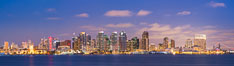 San Diego city skyline at sunset, showing the buildings of downtown San Diego rising above San Diego Harbor, viewed from Harbor Island. California, USA. Image #27889