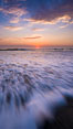 Waves rush in at sunset, Carlsbad beach sunset and ocean waves, seascape, dusk, summer. California, USA. Image #27969