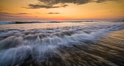 Waves rush in at sunset, Carlsbad beach sunset and ocean waves, seascape, dusk, summer. California, USA. Image #27974