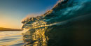 Sunrise glints yellow on breaking wave, dawn surf. The Wedge, Newport Beach, California, USA. Image #27977