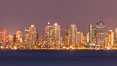 San Diego city skyline, dusk, clearing storm clouds. California, USA. Image #28010