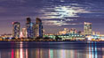 Full moon rising over San Diego city skyline, sunset, storm clouds, viewed from Coronado Island. California, USA. Image #28025