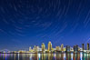 Star Trails over the San Diego Downtown City Skyline.  In this 60 minute exposure, stars create trails through the night sky over downtown San Diego. San Diego, California, USA. Image #28383