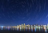 Star Trails over the San Diego Downtown City Skyline.  In this 60 minute exposure, stars create trails through the night sky over downtown San Diego. San Diego, California, USA. Image #28384